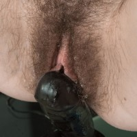 Euro amateur Yana Cey finger-tickling her furry snatch while riding suction dildo