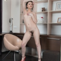 Euro solo female Dea Ishtar loosing lil' knockers and fur covered cunt while undressing