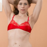 Euro solo girl Elza displaying unshaven slit while rolling off tan stockings