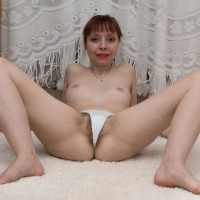 European babe with diminutive melons gliding bloomers aside to reveal fur covered vagina