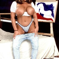 Legendary MILF pornographic starlet Tawny Peaks extracting monster fun bags attired faded denim jeans