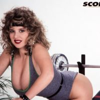 Well-known old X-rated starlet Tracy West uncorks her lovely melons on home gym equipment