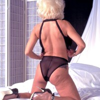Prominent XXX adult starlet Buxom Dusty bares her hefty fun bags in see through underwear and high-heels
