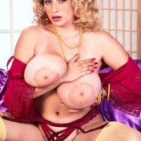 Prominent X-rated actress Crystal Topps whips out her big fun bags in tights and garters
