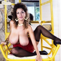 Well-known X-rated film starlet Devon Daniels flaunts her massive funbags clad black pantyhose