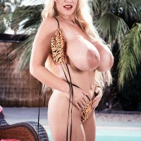 Notorious XXX actress Honey Moons frees her monster-sized fun bags from her swimsuit top