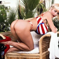Notorious adult film star Pandora Peaks frees her giant tits from a USA themed swimsuit