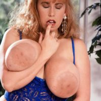 Famous XXX actress Tabatha Towers plays with her big titties in milky hosiery