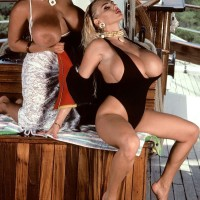 Notorious XXX star Tawny Peaks and lezzie wife free huge boobies from swimsuits on boat
