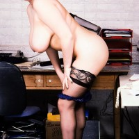 Well-known XXX pornstar Toni Evans frees her large breasts and large ass from uniform in pantyhose