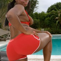 Obese black female Keyona Kay lubricating up cool enormous booty outdoors by swimming pool
