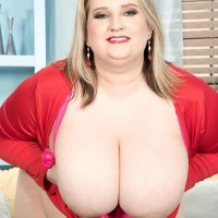 Plus size platinum-blonde girl Porsche Dali reveal her enormous funbags as she strips to her pink panties