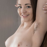 Nimble first timer model Virgin Bloom displays her furry pits and hairy cootchie in the nude