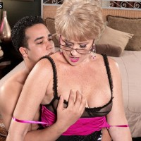 Glasses garmented MILF over Fifty Tracy Gobbles seducing junior boy with a hand job