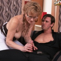 Grannie in glasses seduces a junior stud and bj's his cock on couch