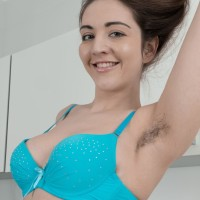 Fur covered solo girl Virgin Bloom peels off her dress and lingerie to model in the nude
