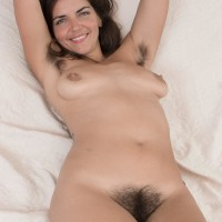 Hirsute black-haired Katie Z peels off her body-suit to make her naked modelling debut outdoors