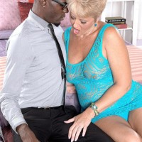 Horny grannie Tracy Munches entices a junior black guy by flashing her enormous all-natural hooters