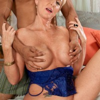 Enticing light-haired grannie Honey Ray has her young ebony lover blow her gash and pooper as well