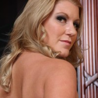 Mind-blowing platinum-blonde girlfriend Ashley Edmunds makes her slave spouse gobble her strap on dick