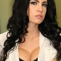 Irresistible dark haired female Emmanuelle London sheds her micro-skirt to unveil her bald honeypot