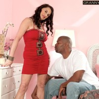 Sweet dark-haired granny Rita Daniels seduces a younger ebony man with her amazing legs