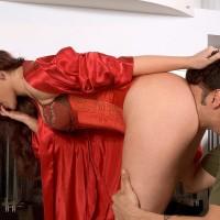 Seductive dark haired MILF Caroline Pierce has her immense ass and muff sucked in a satin corset