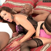Sumptuous grandmother Mimi Moore gives a gigantic black cock a blow-job in sexy lingerie and nylons