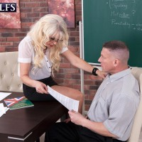Super-sexy mature teacher Doll S tempts a male student in a ebony micro-skirt and glasses