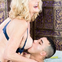 Sexy aged dame Kendall Rex letting huge breasts loose while seducing younger guy