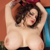 Beguiling solo babe Ariana Angel revealing tits garmented leg warmers and skirt
