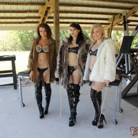 Isobel Raven and girlfriends abase and flog restricted male slave on confine bondage table