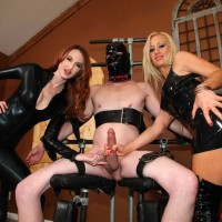 Spandex clad Mistresses Zoey and Kendra jacking off confined and masked male sub