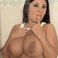 Latina MILF Daylene Rio bares her gigantic knockers from moist tee-shirt and brassiere