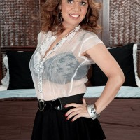 Latina solo girl Marisa Carlo unleashing cute boobs and upskirt panties in pumps