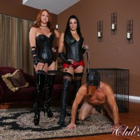 Leather adorned Dominas Michelle & Lacy manhandling hooded male slave in lengthy boots
