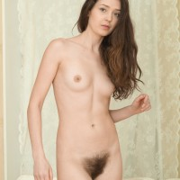 Tall first-timer black-haired Lisa Carry baring truly fur covered cunt from panties