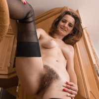 Lengthy legged fair-haired amateur in stockings letting out puny tits and fur covered cooch in stilettos