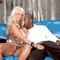 Thin platinum-blonde MILF Brittany O'Neil letting out big boobies for black boy on leather couch