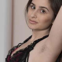 Long-legged European amateur Penelope Fiore displaying wooly armpits and spread beaver