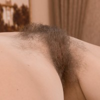 Lumbering European amateur Ira caressing monster-sized natural tits while spreading unshaven snatch
