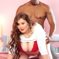 Lengthy haired BIG BEAUTIFUL WOMAN Lilli Blue strokes on a BIG BLACK DICK after having her huge ass and knockers freed