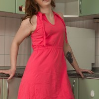 Lengthy sock garbed first timer Kira Fox releasing smallish boobs and wooly snatch in kitchen