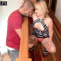 Experienced sandy-haired cougar Rebecca Williams seducing junior stud for sex on bed