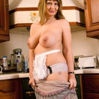 Aged blonde housewife lets her enormous all natural fun bags loose in her kitchen