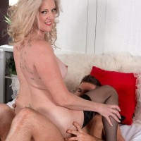 Experienced yellow-haired woman Val Kambel entices a junior guy in beautiful lingerie and stockings