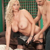 Experienced light-haired MILF Karen Fisher is undressed of her lingerie and hosiery by her lover