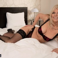 Aged blonde lady tongues and deepthroats on a enormous cock in her black stockings