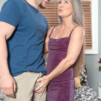 Experienced doll Leilani Lei and junior boy disrobing each other on her bed