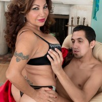 Older dame Sandra Martines seduces a junior stud in brassiere and panties combo